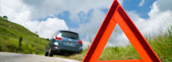 061-Hazard-triangle-with-car-in-background-resized.jpg