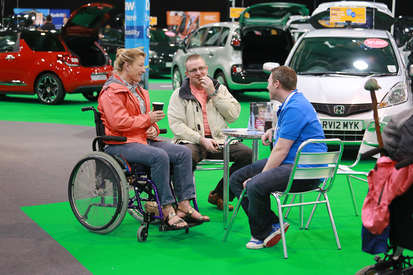 Customer chatting to Motability advisor over coffee at One Big Day.jpg