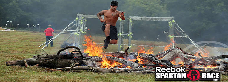 Man tackling obstacle in Reebok Spartan race