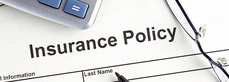 insurance-policy-form-with-pen-and-eye-glasses